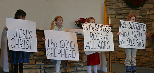 children-holding-Jesus-posters
