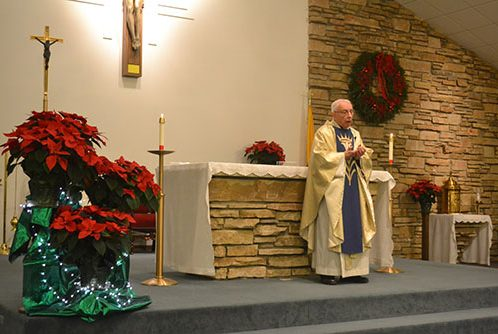 father-otto-celebrates-christmas-eve-mass