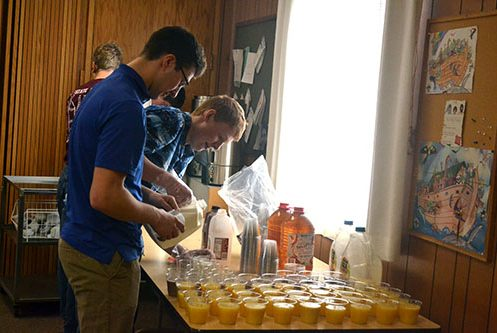 students-pouring-juice-image