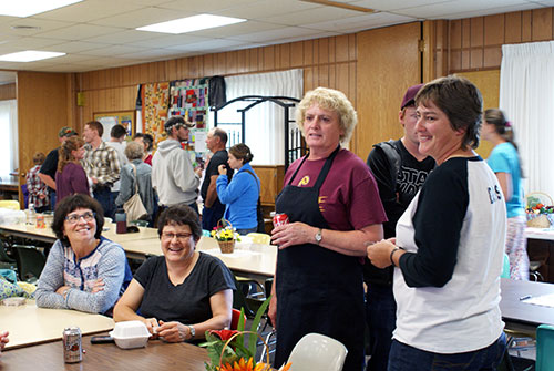 women sitting at table at raffle drawing