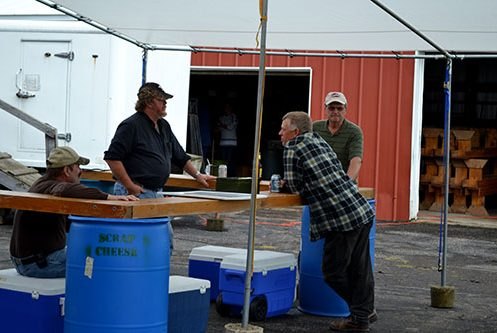 group of men working the refreshment stand