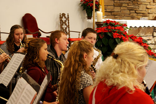 The band plays Christmas music before Mass