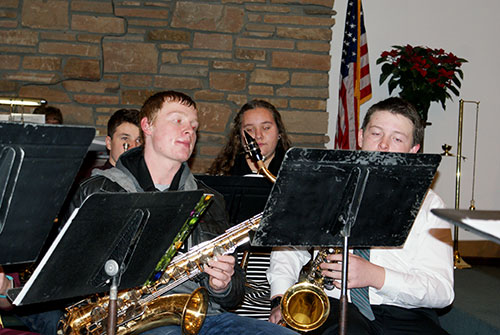 Two saxophone players in the front row
