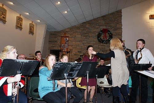 Lori directs the band