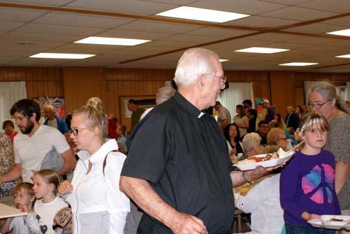 Father Dennis enjoys the dinner at Good Shepherd fall fest