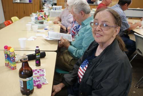 Carol plays bingo at Good Shepherd fall fest