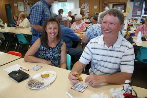 Donna and Leon enjoy playing bingo at Good Shepherd fall fest