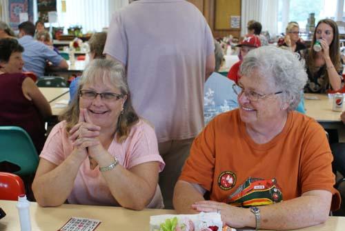 Sue Ann and Carolyn play bingo at Good Shepherd fall fest