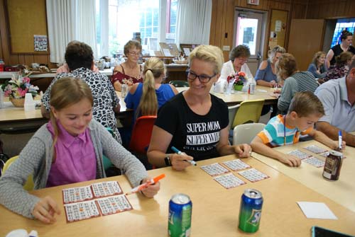 Stacy and daughter play bingo at Good Shepherd fall fest