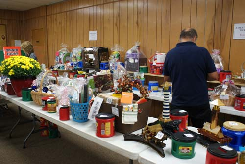Ben checks out the tables full of baskets for the Good Shepherd raffle