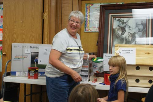 Deb is ready to draw names for large raffle items at Good Shepherd fall fest