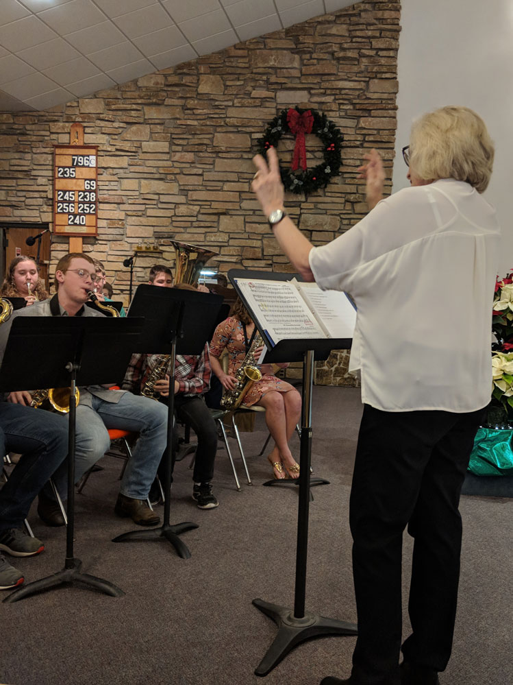 Laurie directs the band at Good Shepherd's Christmas Eve Mass