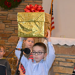 Christmas pageant boy with gift image