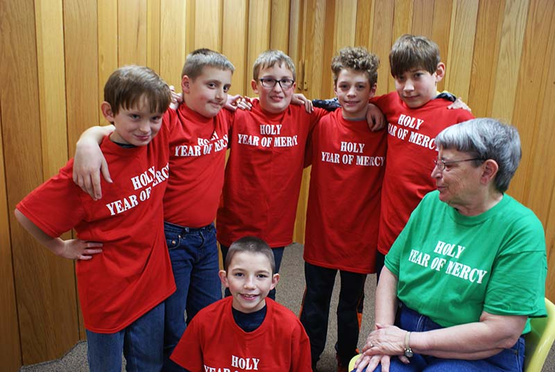 image of 5th graders in year of mercy t-shirts