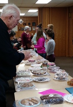 image of Father Dennis at bake sale