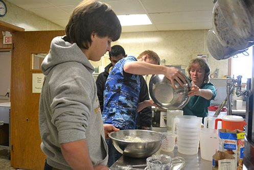 students-pouring-pancake-batter-image