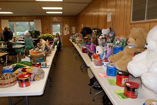 view of tables filled with baskets for raffle