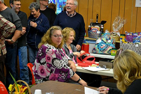 crowd gathers at basket raffle