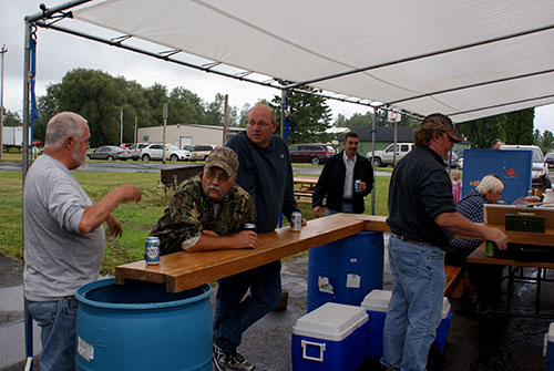 group of men at refreshment stand