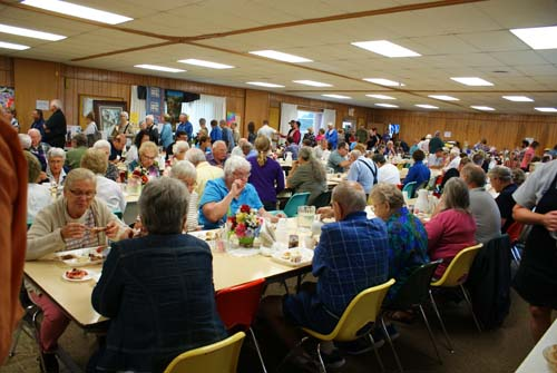 a view of all the tables full of diners in the hall at Good Shepherd fall fest
