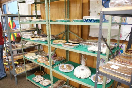 shelves full of baked goods for the cake paddle game at Good Shepherd fall fest