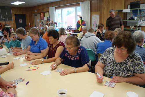 tables full of women playing bingo at Good Shepherd fall fest