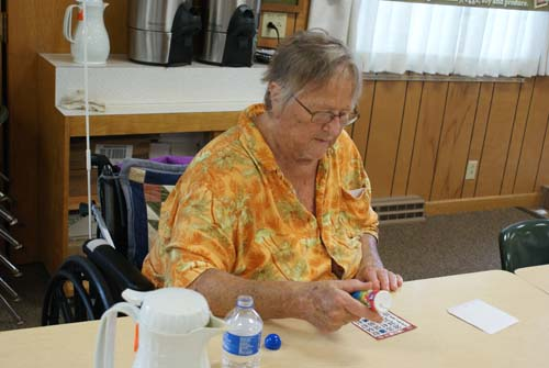 Diane concentrates on her bingo card at Good Shepherd fall fest