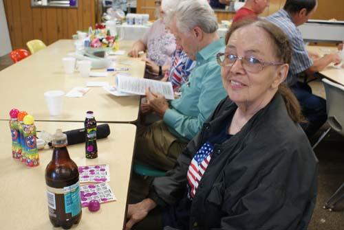 Carol plays bingo at Good Shepherd fall fest