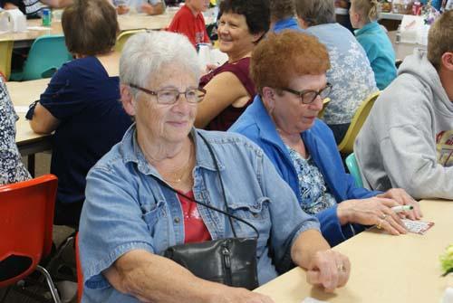 two ladies enjoy playing bingo at Good Shepherd fall fest