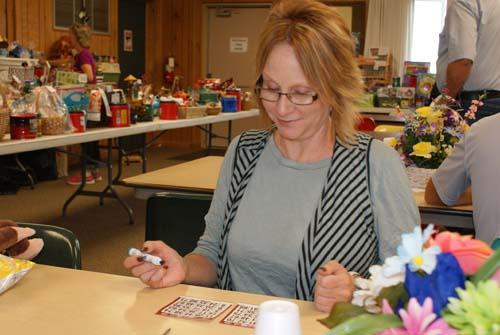 Tami plays two bingo cards at Good Shepherd fall fest