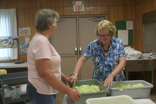 Laura and Pat mix up tubs full of cole slaw for Good Shepherd fall fest dinner