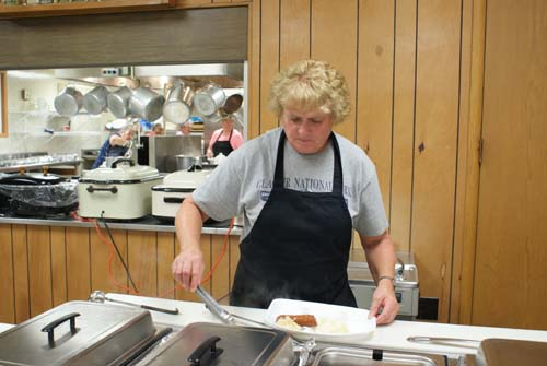 Mary Lou fills a plate to go at Good Shepherd fall fest dinner