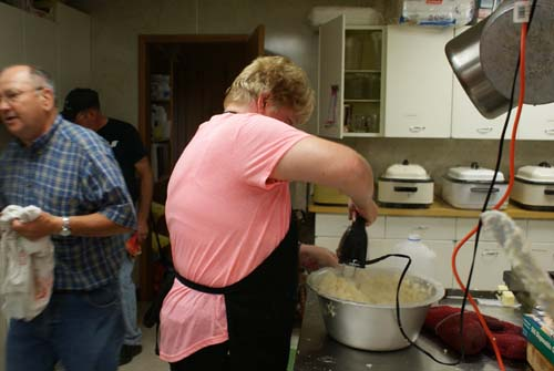 Debbie mixing mashed potatoes for Good Shepherd fall fest dinner