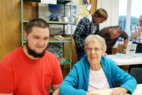 Reid and Gladys play bingo with David and Ken in the background at Good Shepherd fall fest
