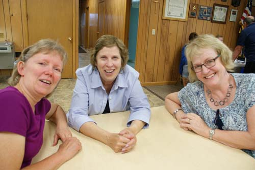 Joan and Bev and Pat lean in for a picture at Good Shepherd fall fest