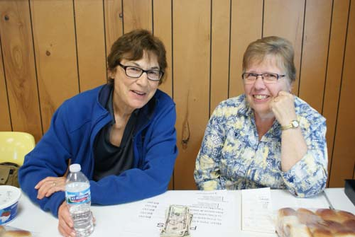 Cheryl and friend take a break at Good Shepherd fall fest