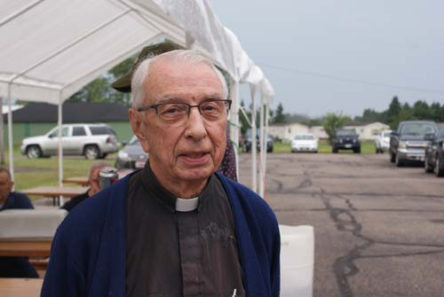 Father Otto enjoys the festivities outside at Good Shepherd fall fest