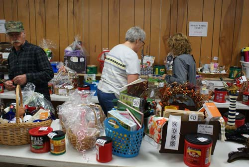 Ron and Deb and Chris at the Good Shepherd basket raffle