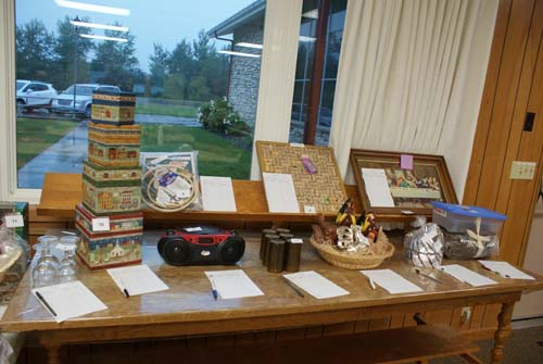 A table full of silent auction items at Good Shepherd fall fest