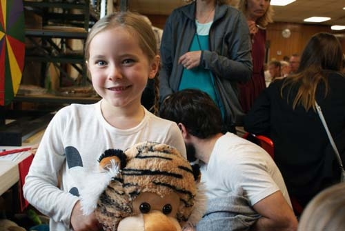 little girl wins a big stuffed tiger at Good Shepherd fall fest