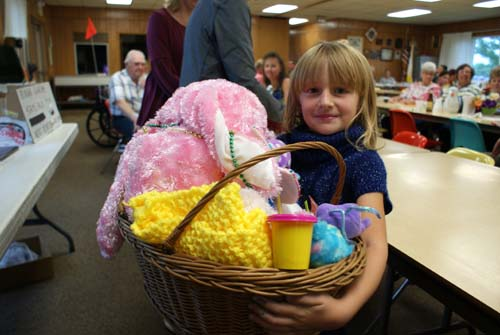 little girl wins a big basket at Good Shepherd fall fest
