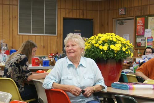 Judy wins a big pot of yellow mums at Good Shepherd fall fest