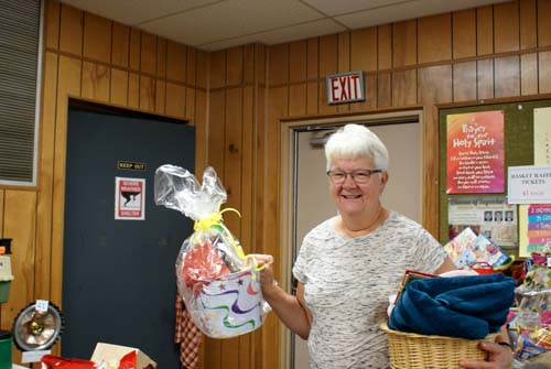 Luanne shows off two baskets she won at Good Shepherd fall fest