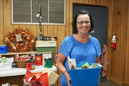 Barb collects basket she won at Good Shepherd fall fest