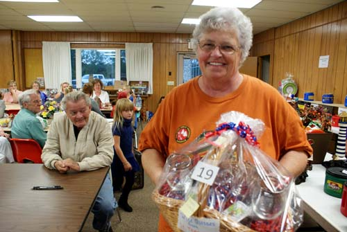 Carolyn shows off the basket she won at Good Shepherd fall fest