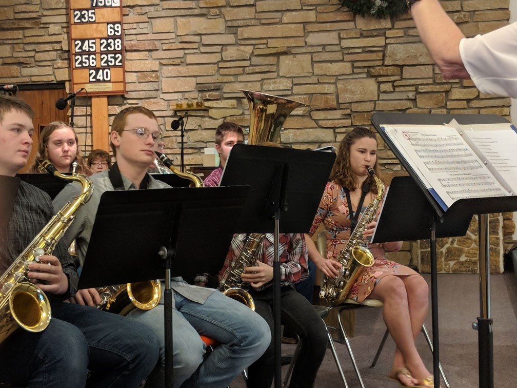 Close-up view of the saxophone section of the Good Shepherd Christmas Eve Band