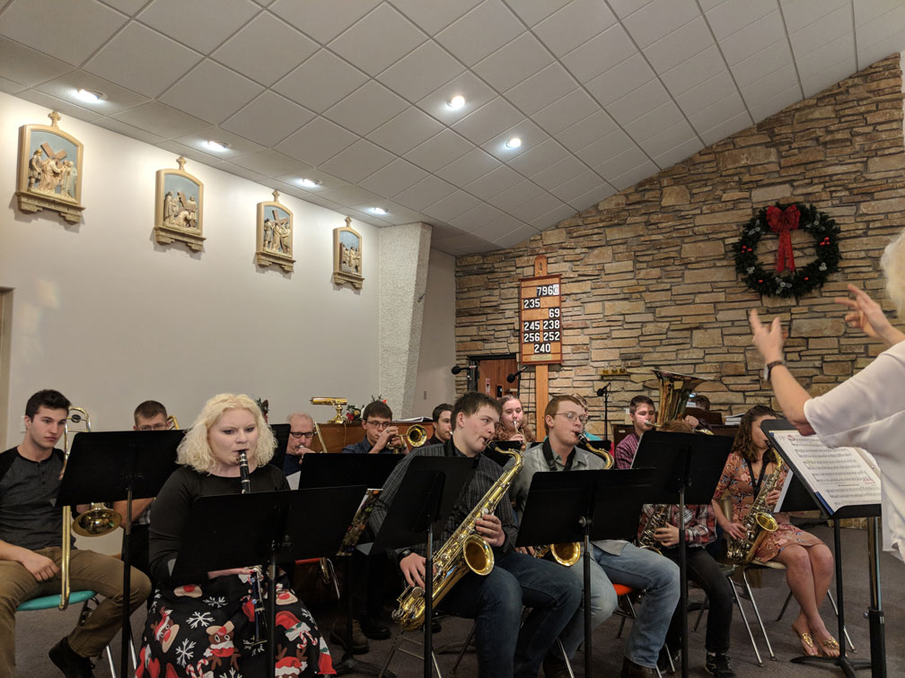Laurie directs the band at Good Shepherd Christmas Eve service